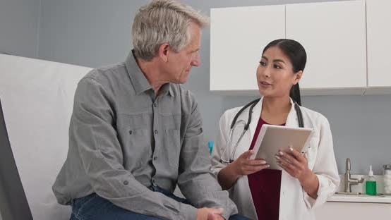 Thumbnail for Primary care doctor explaining medical issue to senior male patient in exam room