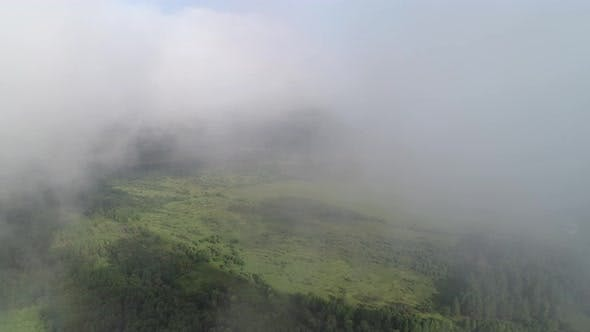 Smooth and Slow Take-off Over the Field and Forest. Fly Through a Layer of Clouds.