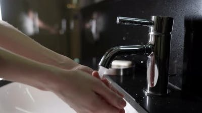 Hygienic Procedure of Washing Hands with Disinfecting Soap Woman is Opening Tap and Washing Hands