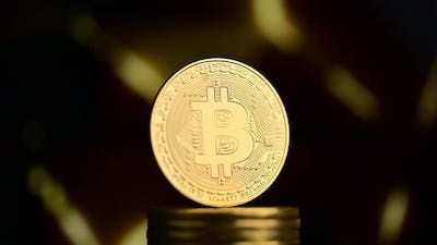 Bitcoin with gold background