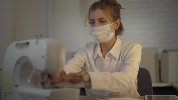 Thumbnail for Portrait of Confident Seamstress Sewing Covid-19 Face Masks During Coronavirus Global Pandemic