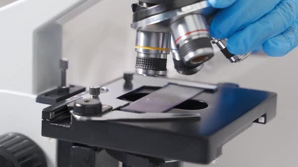 A Modern Microscope in a Sterile Bright Laboratory Room Analyzing Cell Samples