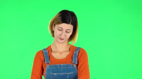 Thumbnail for Young Woman Stands Waiting with Boredom. Green Screen