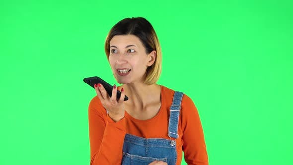 Cover Image for Girl Asks for Information on the Network Via Phone on Green Screen