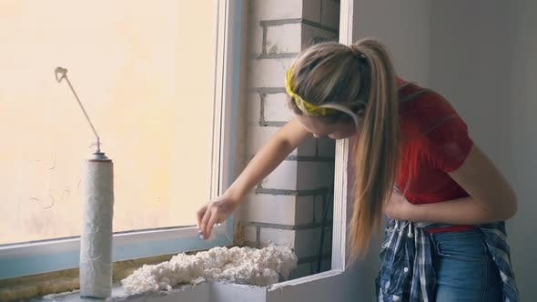 Woman Cleans Frame of Window at Construction in Apartment