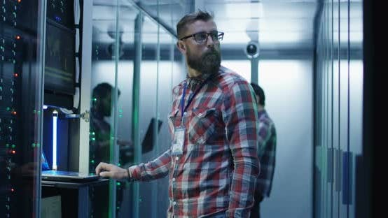 Thumbnail for Bearded IT Specialist Setting Servers in Data Center