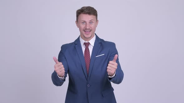Thumbnail for Indecisive Bearded Businessman Giving Thumbs Up and Thumbs Down