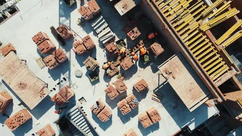 Aerial View on Top Construction of a House of Red Brick