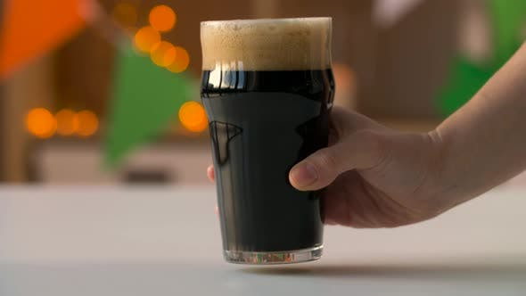 Thumbnail for Hand Putting Glass of Dark Draught Beer on Table