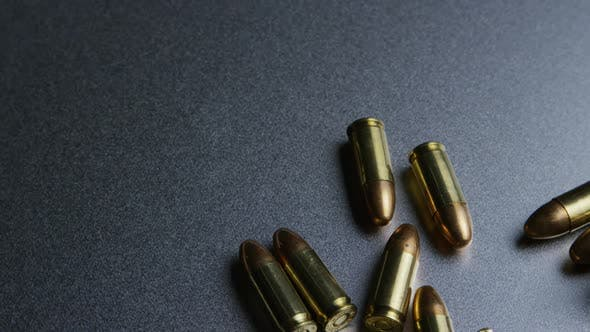 Cinematic rotating shot of bullets on a metallic surface - BULLETS 044