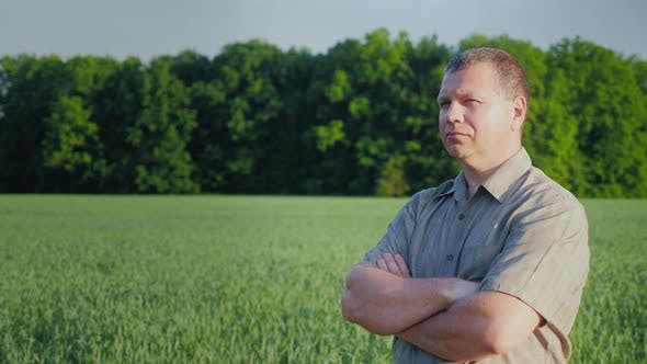 Cover Image for Middle-aged Self-confident Farmer Examines His Field
