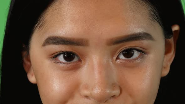Thumbnail for Eyes of an Asian Woman Looking To the Camera