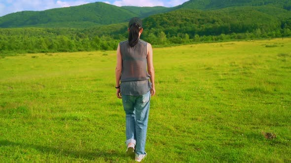 Female Walking on the Field Active Lifestyle