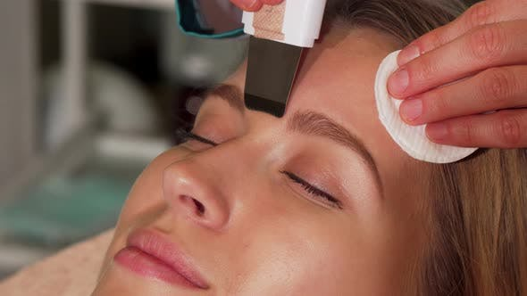 Thumbnail for Young Woman Undergoing Ultrasonic Facial Treatment at Beauty Salon
