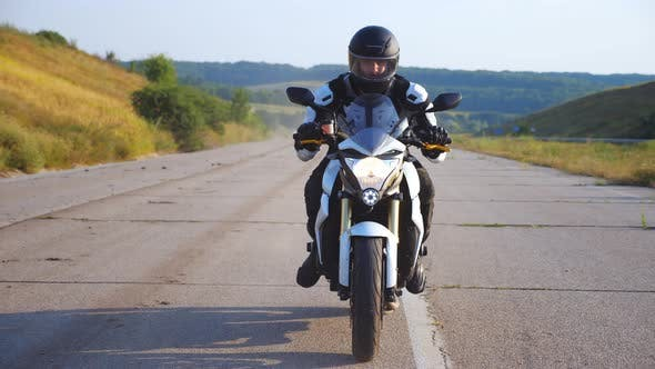 Thumbnail for Man in Helmet Driving Powerful Sport Motorbike at Highway with Beautiful Background. Motorcyclist