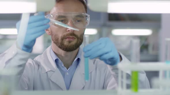 Thumbnail for Male Scientist Working in Laboratory