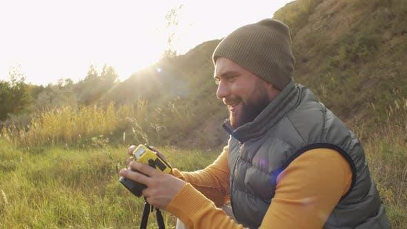 Happy Man Taking Photos on Sunny Day