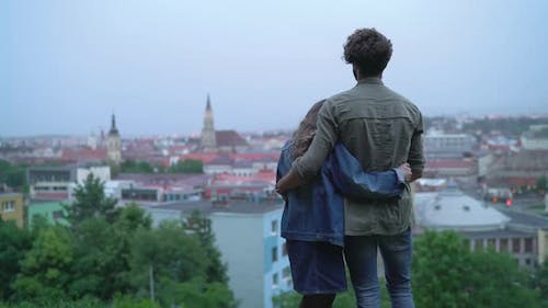 Couple admiring the city and kissing