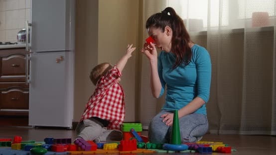 Thumbnail for Parents Using Learning Games For Children To Develop Creative Thinking Happy Family Playing Together