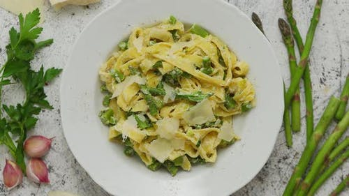 Homemade Tagliatelle Pasta with Creamy Ricotta Cheese Sauce and Asparagus Served White Ceramic Plate