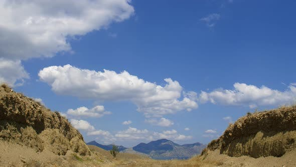Thumbnail for Mountainous Landscape, Cirrus Clouds Are Running Across the Blue Sky