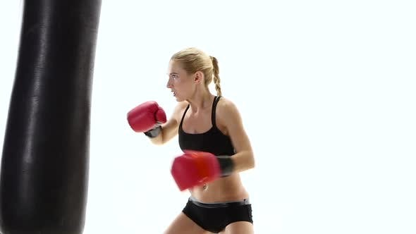 Cover Image for Sportswoman Boxing Champion Fulfills Blows on the Punching Bag