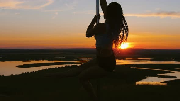 Thumbnail for Pole Dance on Sunset - Attractive Woman with Long Braids Dancing