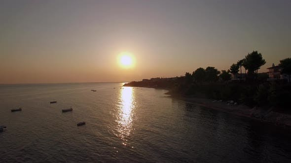 Thumbnail for Aerial Scene of Shore and Sea with Boats at Sunset, Greece