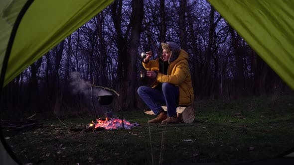Thumbnail for A Man Near a Campfire in the Forest