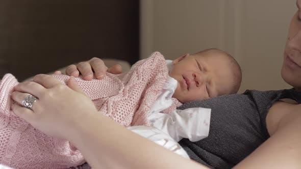 Thumbnail for Newborn Baby Sleeping Well on Mum Chest