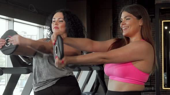 Thumbnail for Beautiful Plus Size Woman Working Out with Her Friend at the Gym