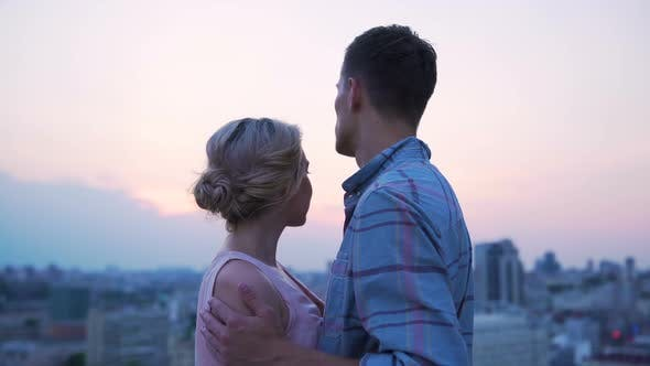 Thumbnail for Man in Love Stroking Shoulders of His Female Lover, Admiring Sunset on Roof