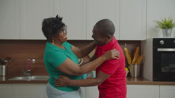 Thumbnail for Happy Retired African Couple Dancing in Kitchen