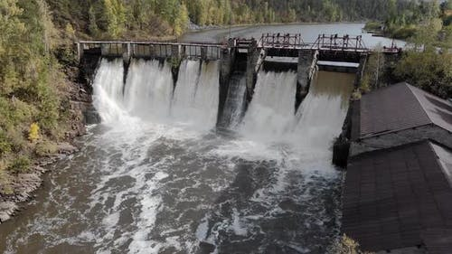 Dam on the River - Water Falls From a High Dam