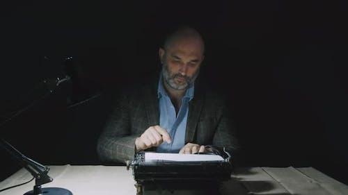 Vintage Reporter Working at Desk