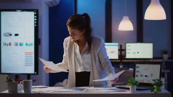 Stressed Manager Woman Working with Financial Documents