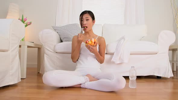 Thumbnail for Healthy Asian woman eating fruit