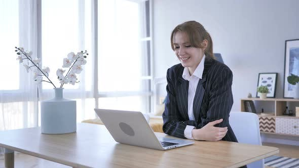 Thumbnail for Woman Doing Online Video Chat on Laptop at Work