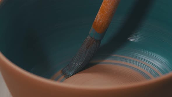 Thumbnail for Painting a Pot in Blue Color Using a Brush