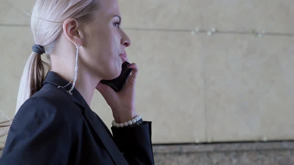 Thumbnail for Close-up Video of a Businesswoman Walk and Talking Mobile Phone.