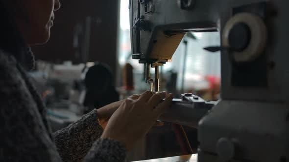 Seamstress Working on Sewing Machine Stitching Textile
