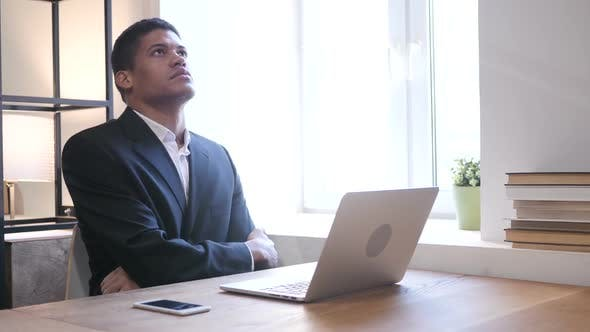Thumbnail for Black Businessman Upset by Loss while Working on Laptop