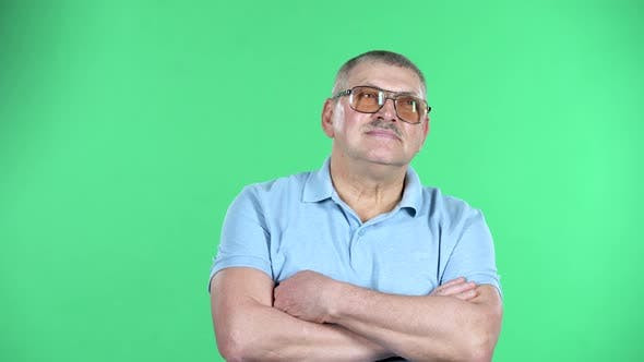 Thumbnail for Portrait of Aged Man Is Waiting, Isolated Over Green Background.