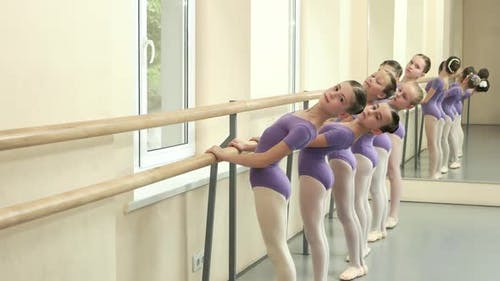 Group of Balletdancers Training at Barre
