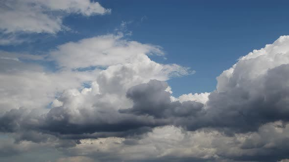 Thumbnail for Bright Cumulus Rain Clouds Moving On The Sky