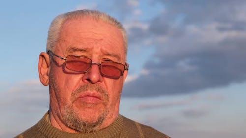 A Sad Depressed Old Grandfather a Sad Elderly Man