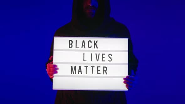 Thumbnail for Dramatic Man in Hood Hold Black Lives Matter Sign