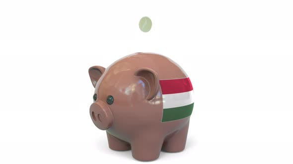 Thumbnail for Putting Money Into Piggy Bank with Flag of Hungary