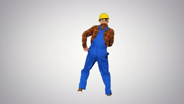 Thumbnail for Construction Worker in Helmet Dancing on Gradient Background.