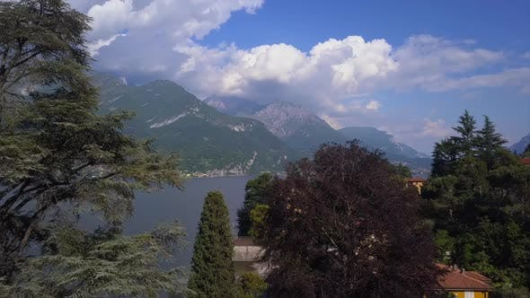 Thumbnail for Aerial Flying Over Mountain Lake Como in Italy, Lakeside Villages and High Mountains on Horizon